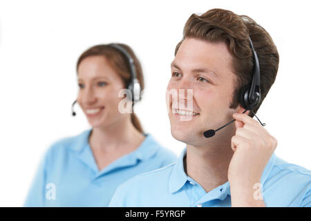 Staff Answering Calls In Customer Service Department - Stock Photo