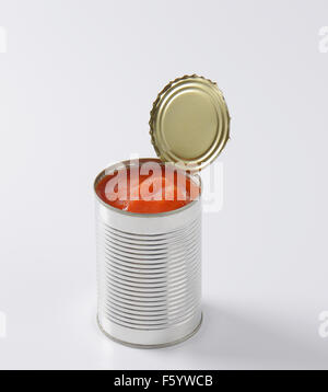 can of peeled tomatoes on white background - Stock Photo