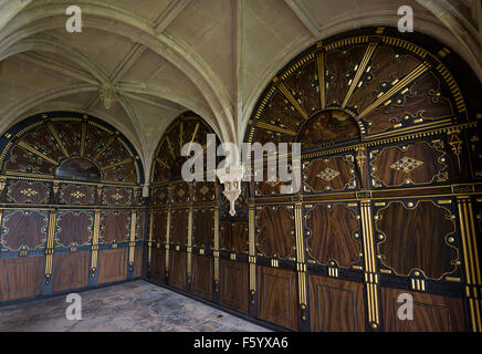 Gold and wood panelling in the panel parlour at Bolsover castle, Derbyshire. - Stock Photo