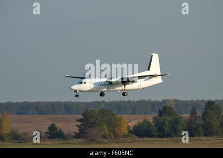 Regional turboprop passenger plane on short final landing - Stock Photo