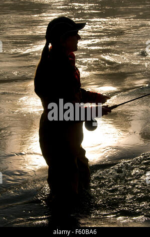 Flyfishing silhouette on McKenzie River, Power Canal EWEB Access Site, Lane County, Oregon - Stock Photo