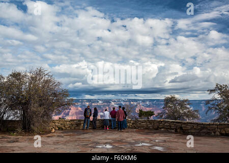 Grand Canyon National Park, Arizona - Tourists taking in an early morning view of the Grand Canyon from the South - Stock Photo