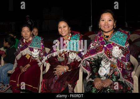 India, Himachal Pradesh, Spiti, Kaza, La Darcha Festival, three women wearing traditional coral and turquoise Spitian - Stock Photo