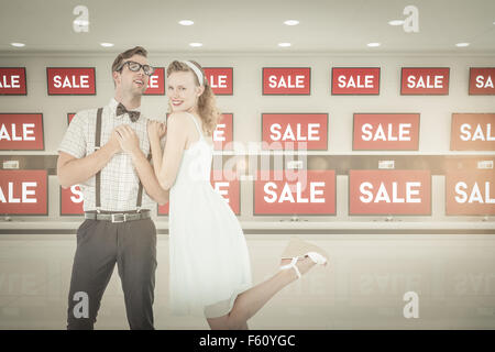Composite image of hipster couple having fun together - Stock Photo