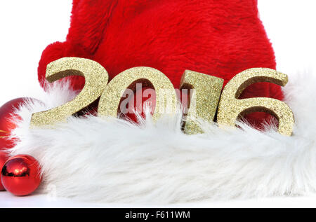 2016 golden figures on santa klaus hat - Stock Photo