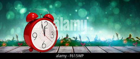 Composite image of alarm clock counting down to twelve - Stock Photo