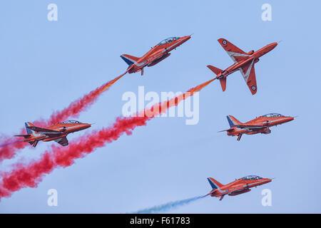 Demo flight RAF 'Red Arrows' on BAE Hawk T1 during Dubai AirShow - Stock Photo