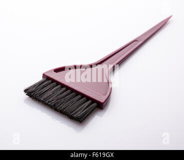 Black bristled paint brush  against white background. - Stock Photo
