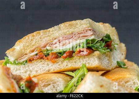 Italian sandwiches, ham, mozzarella, dried tomatoes and olive oil. - Stock Photo