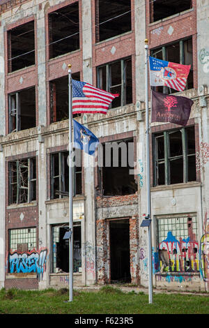 Detroit, Michigan - Newly-installed flags fly in front of the long-abandoned Packard plant. - Stock Photo
