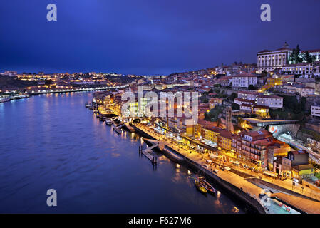 Night view of Porto from Dom Luis I bridge. You can see the Ribeira district and river Douro. - Stock Photo