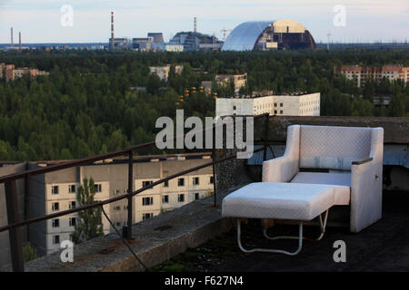 The abandoned town of Pripyat and the nearby Chernobyl Nuclear Power Plant seen from the roof of a high-rise building. - Stock Photo