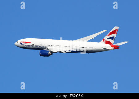 London Heathrow, United Kingdom - August 28, 2015: A British Airways Boeing 777 with the registration G-YMMK taking - Stock Photo