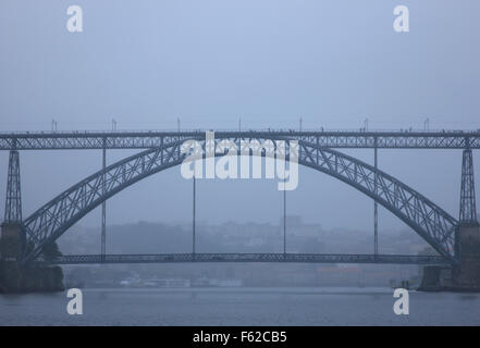 Dom Luis I bridge  and River Douro during a cruise on a rainy day. Porto, Porte e Norte, Portugal. - Stock Photo