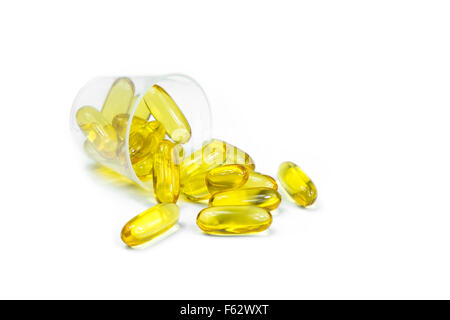 Cod liver oil omega 3 gel capsules in Plastic medicine cup on white background - Stock Photo