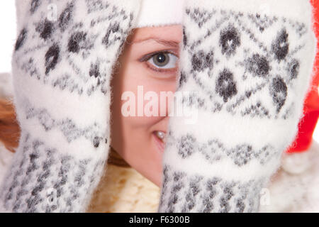 Beautiful young smiling woman hiding in palms - Stock Photo
