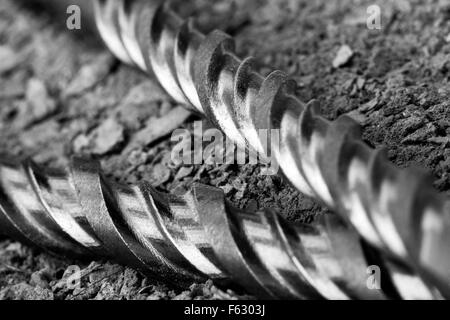 Industrial drills on cracked concrete. Close-up view - Stock Photo