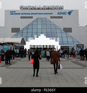 People enter the ExCel London conference centre during the World Travel Market in London, UK. - Stock Photo