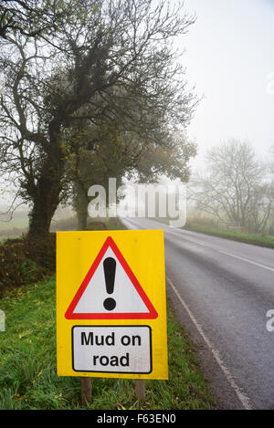 mud on road ahead warning sign in fog yorkshire united kingdom - Stock Photo