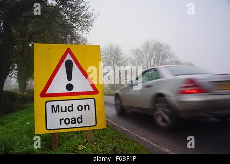 car passing mud on road ahead warning sign yorkshire united kingdom - Stock Photo
