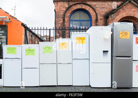 Shop selling second hand fridge freezers and other used white goods or domestic appliances on a UK town high street. - Stock Photo