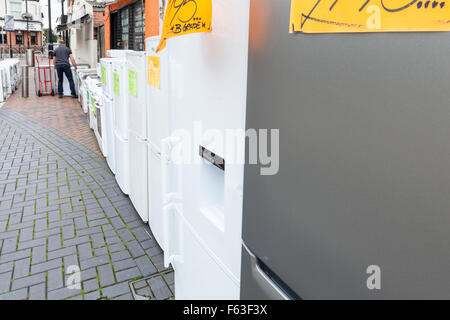 Second hand white goods and domestic appliances for sale on a UK high street. Nottinghamshire, England, UK - Stock Photo
