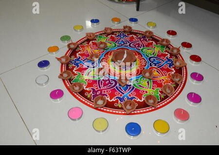 Diwali rangoli with colorful deepak - Stock Photo