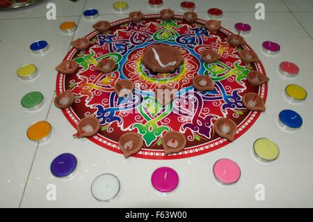Beautiful and colorful rangoli with candle and deepak for Hindu festival Diwali festival - Stock Photo