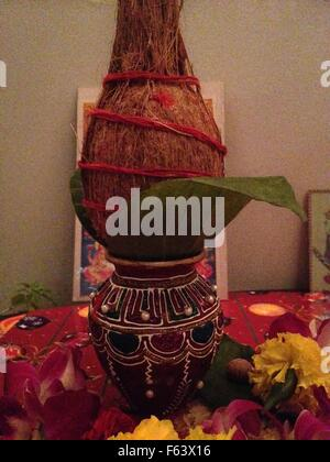 Kalas (Spritual water pot) and Nariyal (Coconut) with panpatta for hindu worship - Stock Photo