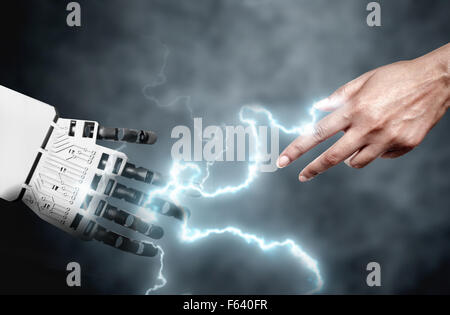 Robot and human connecting through electricity bolts - Stock Photo