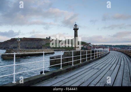 Evening view of 2 lighthouses, harbour entrance and curving West Pier, Whitby, North Yorkshire, GB - Abbey and St. - Stock Photo