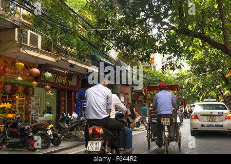 Hanoi, Vietnam: A typical street scene in Hanoi's vibrant Old Quarter. - Stock Photo