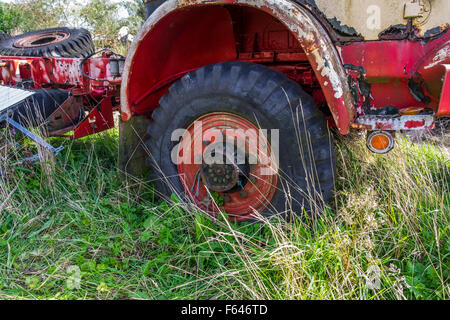 The wheel arch of an abandoned Bedford truck left if a farmers field to rot and rust away, - Stock Photo