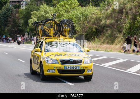 South,France,Tour de France,cycling,Couiza,Aude,Support vehicles with spare bicycles from each team on road near - Stock Photo