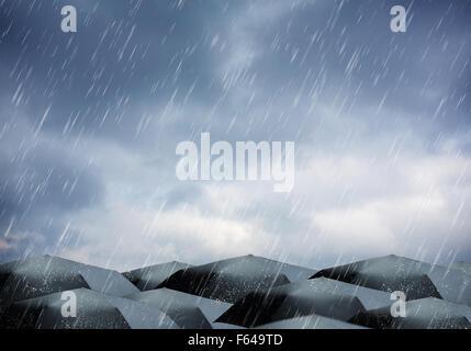 Black umbrellas under rain and thunderstorm - Stock Photo