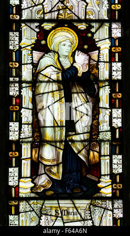 Saint Mary stained glass by Kempe, St. Nicholas Church, Islip, Northamptonshire, England, UK - Stock Photo