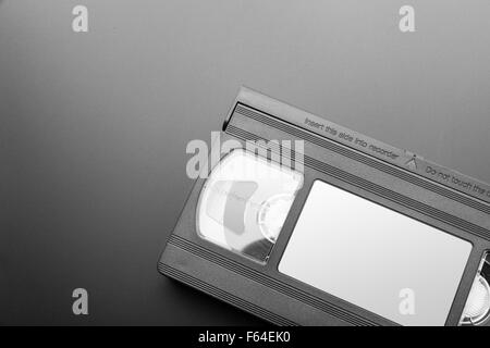 Old video cassette on the grey background - Stock Photo