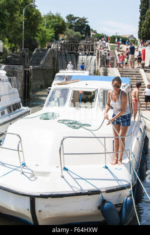 Boats wait at staircase of locks at Fonserannes locks,Beziers,South,France,coast,holiday,Canal,du,Midi,summer, - Stock Photo