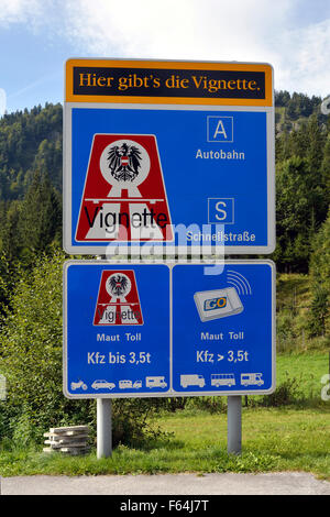 Sign post with reference to the vignette duty on motorway's in Austria. - Stock Photo