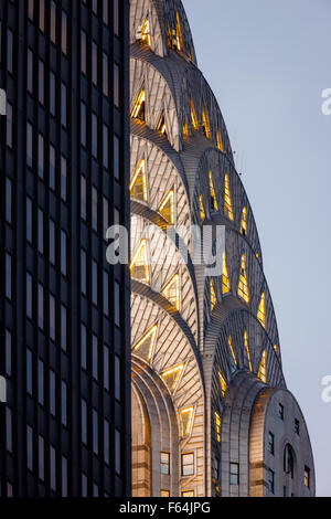 Detail of illuminated Art Deco crown of Midtown Manhattan Chrysler Building before nightfall. New York City. - Stock Photo