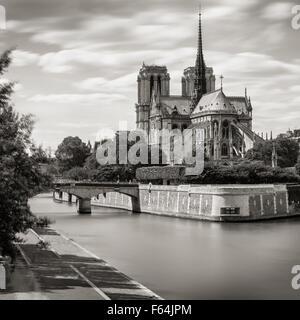 Black & White Notre Dame de Paris Cathedral on Ile de La Cite with the Seine River and Archbishop's Bridge, Paris, - Stock Photo