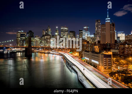 Cityscape at night of Lower Manhattan Financial District with illuminated skyscrapers and World Trade Center. New - Stock Photo