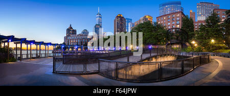 Hudson River Park with Manhattan Financial District skyscrapers. Sunset view of Lower Manhattan with One World Trade - Stock Photo