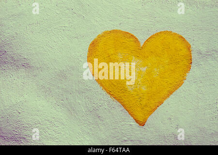 grunge painting heart on the painted concrete wall - Stock Photo