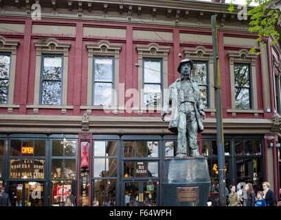 Statue of Gassy Jack  and shops in Gastown neighbourhood of Vancouver, BC, Canada - Stock Photo