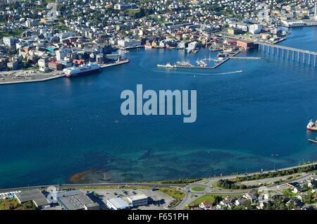 beautiful panoramic overview photo of tromso city island on a sunny summer day with vibrant blue fjord - Stock Photo