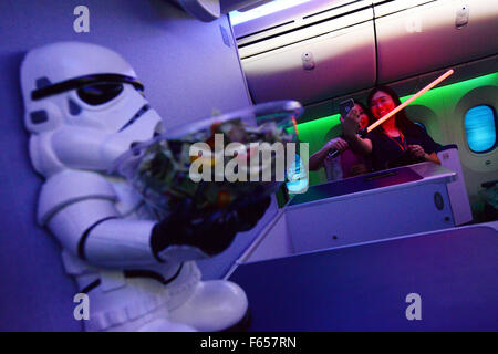 Singapore. 12th Nov, 2015. Visitors take a selfie inside an All Nippon Airlines (ANA) jet with Star Wars R2-D2 livery - Stock Photo