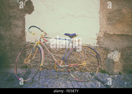 vintage bicycle. Retro stylish cycling in town - Stock Photo