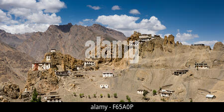 India, Himachal Pradesh, Spiti valley, Dhankar monastery on ridge above village houses on steep slope, panoramic - Stock Photo