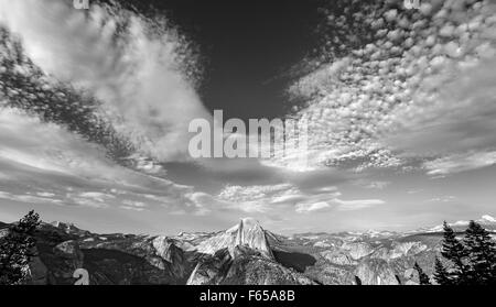 Black and white photo of cloudscape over Half Dome in Yosemite National Park, USA. - Stock Photo
